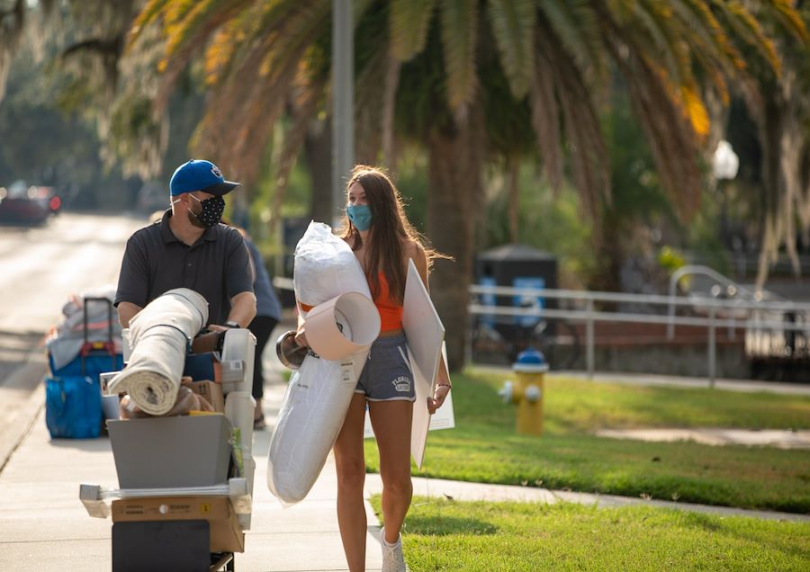 Father helps his daughter move into University of Florida college dorm 2020 photo by UF Housing